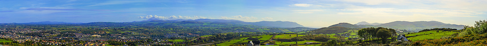 ~180 degree view from Bernish Viewpoint near Newry which can be seen in the foreground to the left. The A1 sweeps passed it on its way south, drawing the eye to the Mourne Mountains, Carlingford Lough and the Cooley Mountains. Image consists of 20 photos taken at 85mm offering stunning levels of detail.