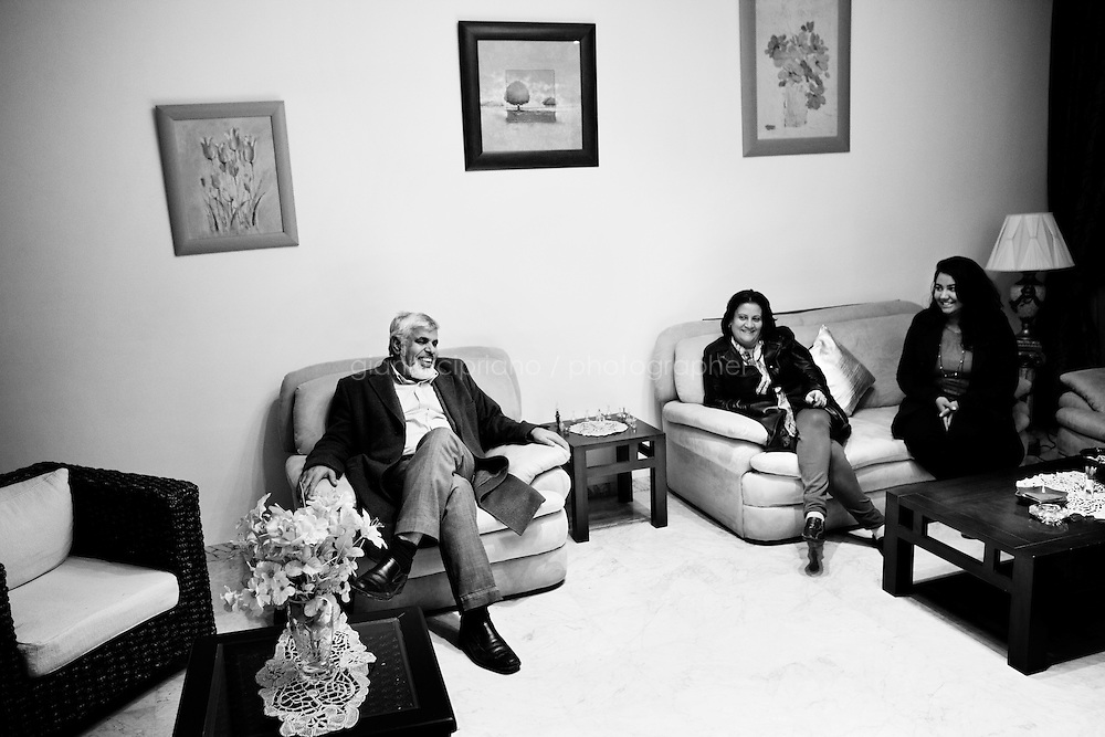 Kairouan, Tunisia - 17 December, 2011: Said Ferjani, 57, senior member of the political and communication bureau of the Nahda (Renaissance) party, is invited by the Abdulhamid Alwini's family in Kairouan, Tunisia on 17 December, 2011. Said Ferjani and Abdulhamid Alwini (not in picture) have been friends since elementary school, and haven't seen each other for 22 years when Said flew the country. Said Ferjani started his activism in the Negra mosque of his hometown Kairouan when he was 16 years old, debating on politics, philosophy, economy and world events. In 1989 former dictator Zine El Abidine Ben Ali turned against Nahda (or Ennahda) and jailed 25,000 activists. Said Ferjani was jailed and tortured. He then flew Tunisia and moved to the UK. He came back to Tunisia after 22 years, after former dictator Ben Ali flew the country.<br /> <br /> Gianni Cipriano for The New York Times