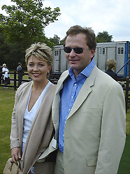 TV presenter KIRSTY YOUNG and MR NICK JONES at a polo match in Berkshire on 13th June 1999.MTD 214