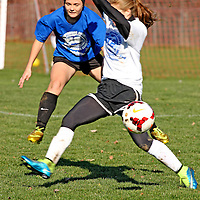 Dana Jones from Maple Grove in blue battles Nicole Cooper from Southwestern during soccer action at Strider Field 11-15-15 photo by Mark L. Anderson