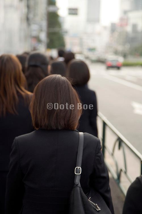 business woman walking along  street in Tokyo
