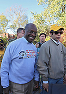 October 22, 2011: Presidential hopeful Herman Cain greets supporters before the start of the NCAA football game between the Indiana Hoosiers and the Iowa Hawkeyes at Kinnick Stadium in Iowa City, Iowa on Saturday, October 22, 2011. Iowa defeated Indiana 45-24.