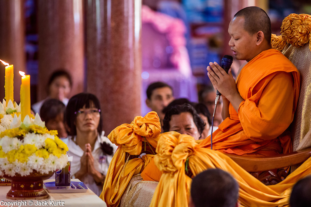 """04 FEBRUARY 2013 - PHNOM PENH, CAMBODIA:  An Cambodian monk preaches during a cremation chanting service for King-Father Norodom Sihanouk at Wat Ounalom (also spelled Wat Onalaom) in Phnom Penh. Norodom Sihanouk (31 October 1922- 15 October 2012) was the King of Cambodia from 1941 to 1955 and again from 1993 to 2004. He was the effective ruler of Cambodia from 1953 to 1970. After his second abdication in 2004, he was given the honorific of """"The King-Father of Cambodia."""" Sihanouk died in Beijing, China, where he was receiving medical care, on Oct. 15, 2012.   PHOTO BY JACK KURTZ"""