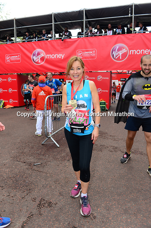 Sian Williams (Channel 5 news anchor running for Heads Together) smiles with her medal after finishing the race. The Virgin Money London Marathon, 23rd April 2017.<br /> <br /> Photo: Joanne Davidson for Virgin Money London Marathon<br /> <br /> For further information: media@londonmarathonevents.co.uk