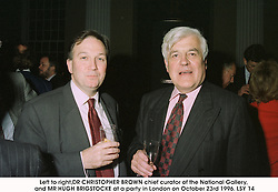 Left to right,DR CHRISTOPHER BROWN chief curator of the National Gallery, and MR HUGH BRIGSTOCKE at a party in London on October 23rd 1996.LSY 14