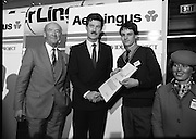 "Aer Lingus Young Scientist Exhibition..1986..10.01.1986..01.10.1986..10th January 1986..The annual Aer Lingus,sponsored,Young Scientists Exhibition was held at the RDS,Ballsbridge,Dublin.The Overall winners of the competition were Ms Breda Maguire and Ms Niamh Mulvany..They are students at The Rosary College,Raheny,Dublin. The Tanaiste, Mr Dick Spring TD was on hand to present the awards...Photograph of Shane Donovan,.Silverdale Road,Ballinlough,Cork being awarded the Runner-up Individual Award By Tanaiste Mr Dick Spring. Dr Michael Dargan,Chairman,Aer Lingus is also pictured..Shane submitted a project called ""The quality of water in the aquifiers of the Cork regionwith reference to industrial development"". Thisis Shane's third entry into the competition. Last year Shane won the ""Chemistry Association Of Ireland Award""..This year as part of his prize,Shane, will be invited to attend the European Space Agency Base on the occasion of the space craft ""Giotto"" meeting ""Halleys Comet""."