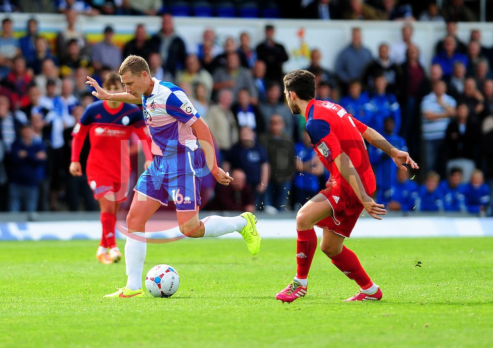 Bristol Rovers' Dave Martin is challenged by AFC Telford's Wes Baynes - Photo mandatory by-line: Neil Brookman - Mobile: 07966 386802 23/08/2014 - SPORT - FOOTBALL - Bristol - Memorial Stadium - Bristol Rovers v AFC Telford - Vanarama Football Conference