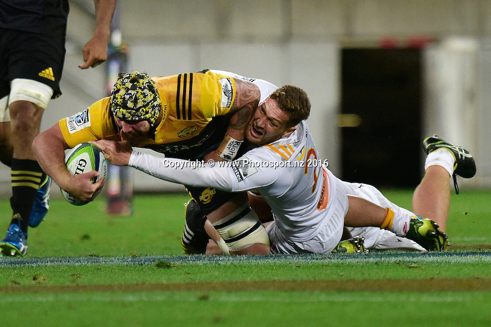 Hurricanes' Blade Thomson (L) is tackled by Chiefs' Tawera Kerr-Barlow during the Hurricanes vs Chiefs Super Rugby match at the Westpac Stadium in Wellington on Saturday the 23rd of April 2016. Copyright Photo by Marty Melville / www.Photosport.nz