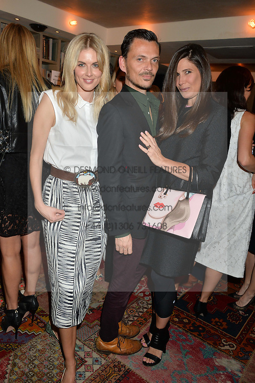 Left to right, DONNA AIR, MATTHEW WILLIAMSON and ELIZABETH SALTZMAN at the Cavan.com Pop-Up sale held at The Belgraves Hotel, 20 Chesham Place, London on 20th May 2014.