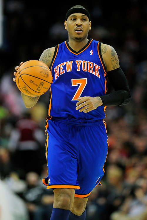 Feb. 25, 2011; Cleveland, OH, USA; New York Knicks small forward Carmelo Anthony (7) drives down court during the second quarter against the Cleveland Cavaliers at Quicken Loans Arena. Mandatory Credit: Jason Miller-US PRESSWIRE