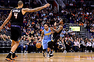 Jan 28, 2017; Phoenix, AZ, USA; Denver Nuggets guard Jameer Nelson (1) handles the ball against Phoenix Suns guard Eric Bledsoe (2) in the first half of the NBA game at Talking Stick Resort Arena. Mandatory Credit: Jennifer Stewart-USA TODAY Sports