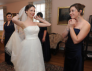 March 25, 2011 - Bride Catie gets ready for her wedding with the help of her sister and bridesmaids Amy and Suzy at the First Parish Unitarian in Medfield, MA.