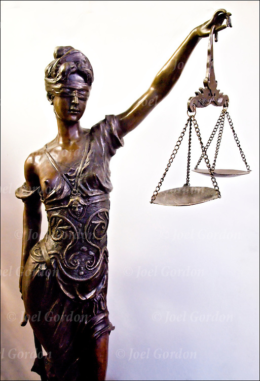 Lady Justice,the Roman Goddess of Justice and sometimes, simply &quot;Justice&quot;<br /> is an allegorical personification of the moral force that underlies the legal system. Since the Renaissance, Justice has frequently been depicted as a bare-breasted woman carrying a sword and scales, and sometimes wearing a blindfold.<br /> <br /> Blind Justice is the theory that law should be viewed objectively. That means that determination of innocence or guilt should be made without bias or prejudice. It is the idea behind the United States Supreme Court motto ?Equal Justice Under Law?. However, it has not always been indicative of fairness.