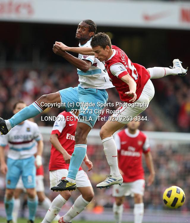 30/10/2010 Premier League football. Arsenal v West Ham United.<br /> Frederic Piquionne challenges Laurent Koscielny.<br /> Photo: Mark Leech.