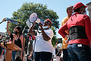 May 30, 2020 A protest organizer addresses the crowd during a protest honoring the life of George Floyd who was killed by police on Memorial Day in Minneapolis, MN