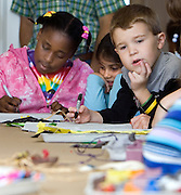 Zenzi Mda (from left), Suzy Abdelquader and Nicholas Arno make art during an outing with East Elementary School students to the new educational space at the Kennedy Art Museum on Friday, 10/6/06.