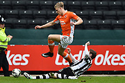 Notts County defender Elliott Hewitt (18) slides in for a tackle on Blackpool midfielder Brad Potts (8) during the EFL Sky Bet League 2 match between Notts County and Blackpool at Meadow Lane, Nottingham, England on 29 April 2017. Photo by Jon Hobley.