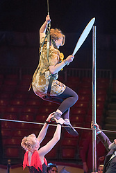 © Licensed to London News Pictures. 22/04/2015. Guildford, UK. Kelly-Marie Blundell takes a tumble as she is guided through the process by comedy artist Vladimir Georgieski and high wire walker Olga Roxhkovskaya. Liberal Democrat Kelly-Marie Blundell walks the high wire at Moscow State Circus in Guildford. Photo credit : Stephen Simpson/LNP