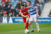 Nottingham Forest midfielder Joe Lolley (23) and Queens Park Rangers forward Ryan Manning (14) during the EFL Sky Bet Championship match between Queens Park Rangers and Nottingham Forest at the Loftus Road Stadium, London, England on 27 April 2019.