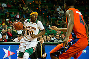 WACO, TX - JANUARY 3: Royce O'Neale #00 of the Baylor Bears drives to the basket against the Savannah State Tigers on January 3, 2014 at the Ferrell Center in Waco, Texas.  (Photo by Cooper Neill) *** Local Caption *** Royce O'Neale