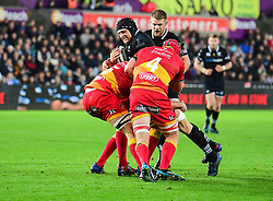 Ospreys' James King is tackled by Dragons' Cory Hill - Mandatory by-line: Craig Thomas/JMP - 27/10/2017 - RUGBY - Liberty Stadium - Swansea, Wales - Ospreys v Dragons - Guinness Pro 14