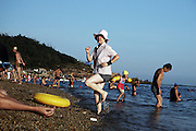 A woman excursuses at the beach in Dalian, Liaoning, China.