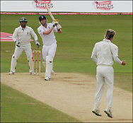 Andrew Flintoff smashes a six to win the test for England as Bowler Paul Harris jumps on the final day day of the fourth Test at the Oval on the 11th of August 2008..England v South Africa.Photo by Philip Brown.www.philipbrownphotos.com