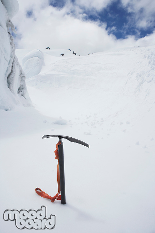 Mountain climbing pick axe in the snow