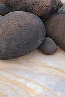 Lava boulders sitting on Kayenta Sandstone, Capitol Reef National Park Utah