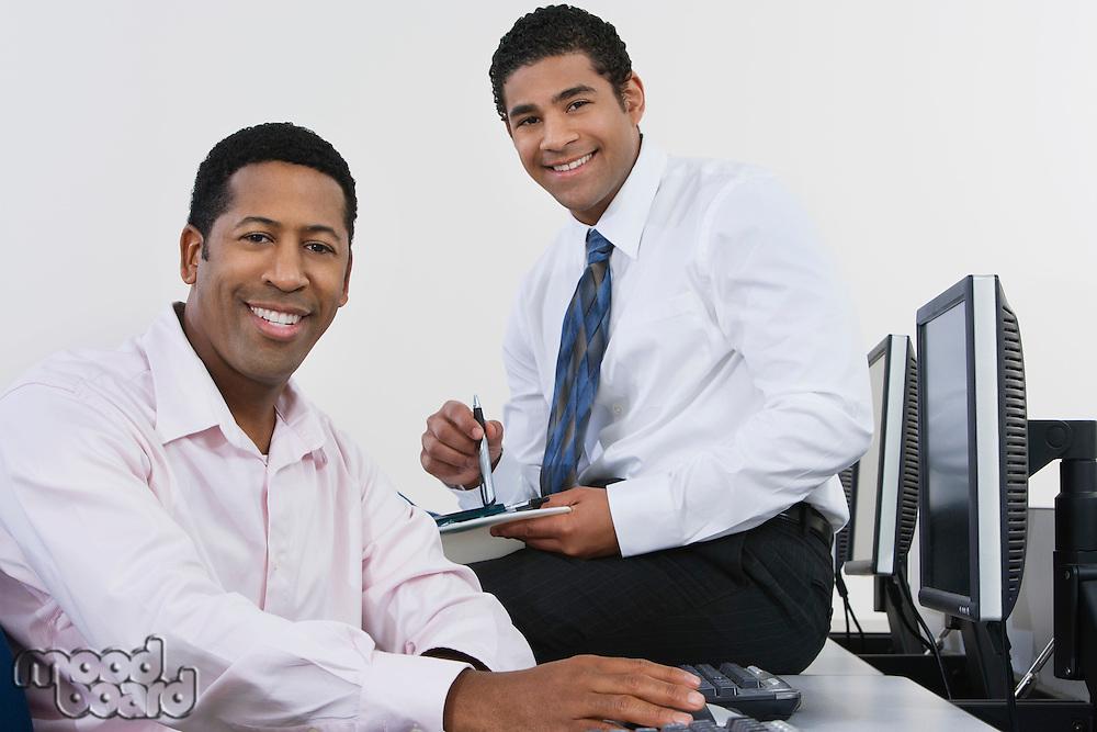 Portrait of two business men in office