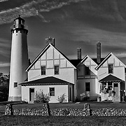 """""""Light so Tall"""" B&W<br /> <br /> A beautiful black and white image of the historic Point Iroquois Light Station in Michigan's Upper Peninsula. <br /> This wonderful lighthouse over looks Lake Superior, and Canada!<br /> <br /> Black and White images by Rachel Cohen"""