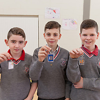 6th Class Sean Moloney, Ben Harnett and Evan Coughlan showing there keyrings