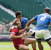 Twickenham. UK. 2015. Sean WHITE is caught with the ball during the Canada vs Samoa.Marriott London Sevens. RFU Twickenham Stadium. Surrey. 16.05.2015. [Mandatory Credit: Peter Spurrier/Intersport Images]