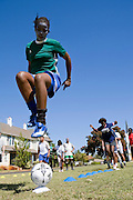 """A painted faced girl shows off her football skills in Cape town, South Africa, where the charity """"Coaching for Hope"""" are working with children. Both Hope Powell and DJ Fatboy Slim work with the charity, whose innovative programme uses football to create better futures for young people in West and Southern Africa."""