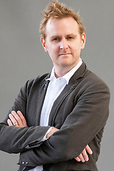 """Edinburgh, Scotland, UK; 16 August, 2018. Pictured; Nick Harkaway. The British author tackles the subject of state surveillance in his book """"Gnomon""""."""