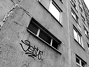 """Jesus"" spray painted on the side of old socialist style apartments from Neighborhoods series"