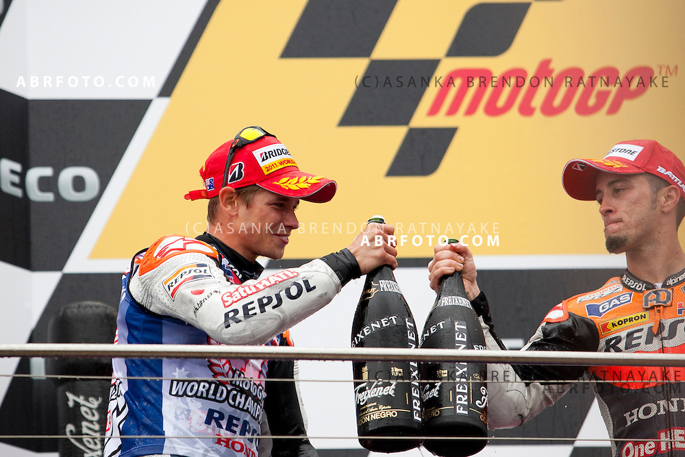 16 October 2011: Race winner & newly crowned 2011 World Champion Australian Casey Stoner congratulates 3rd placed rider Andrea Dovizioso on the podium at the completion of the IVECO Australian MotoGP Grand Prix at the Phillip Island Circuit in Phillip Island, Victoria, Australia.