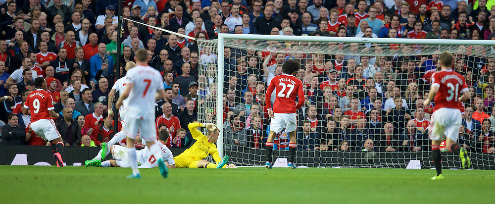 MANCHESTER, ENGLAND - Saturday, September 12, 2015: Manchester United's Anthony Martial scores the third goal against Liverpool during the Premier League match at Old Trafford. (Pic by David Rawcliffe/Propaganda)