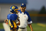 Benton Community head coach Clay Anderson talks with Brandon Wilhelm (24) during the first half of their game between Vinton-Shellsburg and Benton Community at Benton Community High School in Van Horne on Friday evening, August 24, 2012.
