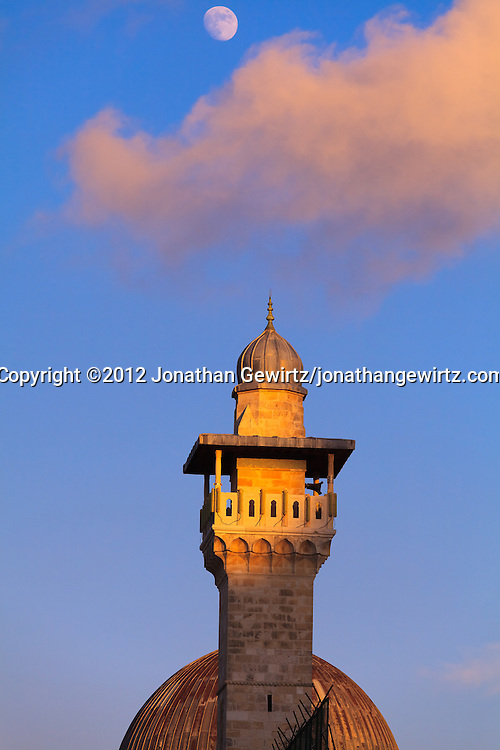The Moon rises over the minaret and dome of the Al Aqsa mosque on the Temple Mount in Jerusalem. WATERMARKS WILL NOT APPEAR ON PRINTS OR LICENSED IMAGES.