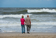 Spring Lake, NJ US -- Sept 3, 2016. A couple stands on the beach watching the ocean churn before an impending storm . Editorial Use Only.