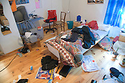 the messy bedroom of a young boy