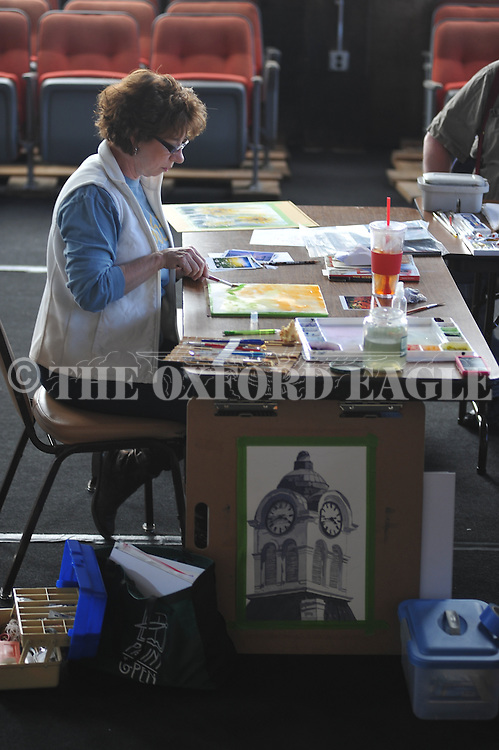 Debbie Myers works on a painting during a watercolor painting class at the Powerhouse in Oxford, Miss. on Tuesday, February 19, 2013.