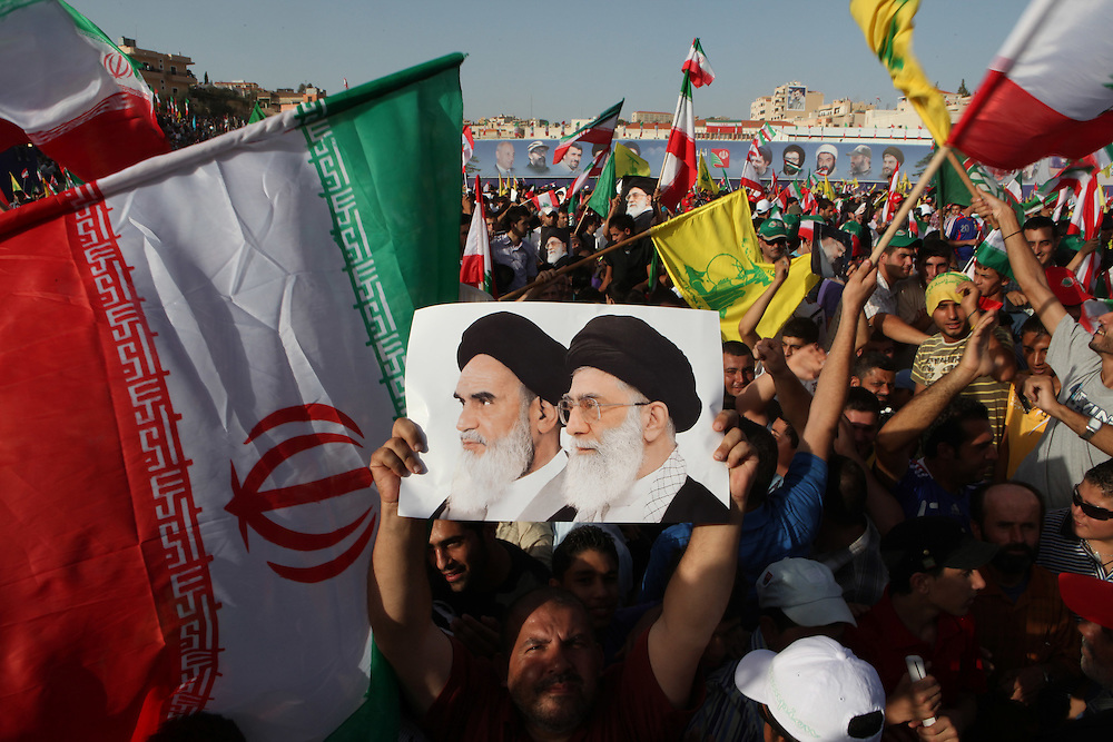 On the second and final day of his visit to Lebanon, Iranian President Mahmoud Ahmadinejad traveled to the southern town of Bint Jbeil. There a Hizballah-organized rally was held to welcome Ahmadinejad to the south Lebanon, an area where Hizballah is widely supported. Tens of thousands gathered for hours holding flags of Iran, Hizballah, Lebanon and other political parties, cheering the Iranian president as he arrived by helicopter from Beirut.