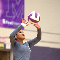 Miyamura Patriot Valynn Nez (1)sets the ball for a teammate to spike during the District Championship game against Aztec Tuesday.