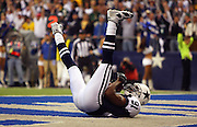 IRVING, TX - NOVEMBER 29: Wide receiver Terrell Owens #81 of the Dallas Cowboys catches a ten yard touchdown pass and lands on his back with his feet in the air to give the Cowboys a 27-10 second quarter lead while tying the club record for touchdown passes (14) during the game against the Green Bay Packers on November 29, 2007 at Texas Stadium in Irving, Texas. The Cowboys defeated the Packers 37-27. ©Paul Anthony Spinelli *** Local Caption *** Terrell Owens