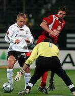 n/z.: Bartosz Karwan (nr14-Legia), bramkarz Piotr Lech (nr1-Zabrze) podczas meczu ligowego Legia Warszawa (biale) - Gornik Zabrze (czerwone) 3:2, I liga polska , 14 kolejka sezon 2005/2006 , pilka nozna , Polska , Warszawa , 18-11-2005 , fot.: Adam Nurkiewicz / mediasport..Bartosz Karwan (nr14-Legia), goalkeeper Piotr Lech (nr1-Zabrze) fight for the ball during Polish league first division soccer match in Warsaw. November 18, 2005 ; Legia Warszawa (white) - Gornik Zabrze (red) 3:2; 14 round season 2005/2006 , football , Poland , Warsaw ( Photo by Adam Nurkiewicz / mediasport )