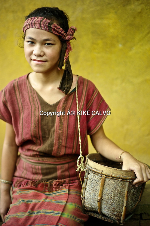 Teen girl wearing a Khmu country side traditional dress in Laos.