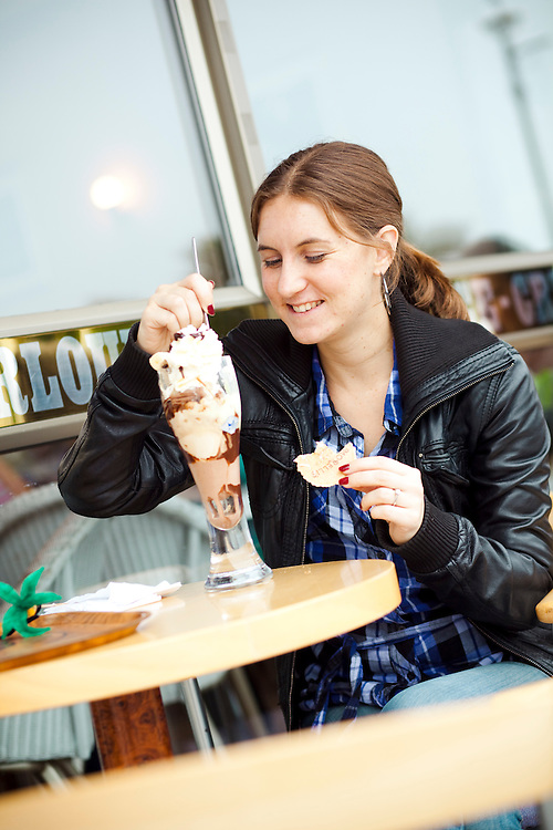 Journalist Helen Ochyra tucks into ice cream. Morellis Ice Cream Parlour, Broadstairs, Kent