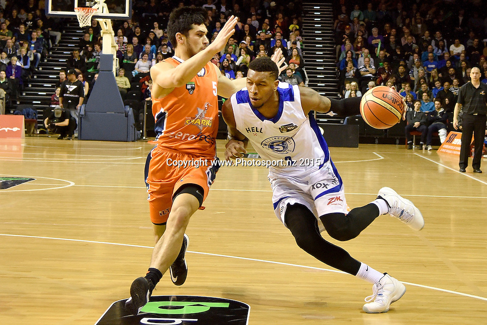Torrey Craig (R of the Saints dribbles the ball with Shea Lli of the Southland Sharks during the NBL final basketball match between Wellington Saints and Southland Sharks at the TSB Arena in Wellington on Sunday the 5th of July 2015. Copyright photo by Marty Melville / www.Photosport.nz